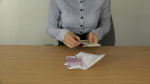 woman-hands-count-money-euro-banknotes-in-envelope-4k_eyzkh4fp__F0000 (2)